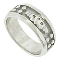 A handsome claddaugh design rests in the center of this 14K white gold mens modern wedding band