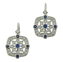 Diamond frosted snowflakes are punctuated by deep blue sapphires on the surface of these fantastic antique style earrings