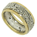 This splendid 14K bi-color vintage wedding band features a central pattern of swirling organic cutout florals decorated with intricate engraving