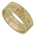 Vignettes of deeply engraved organic figures encircle the face of this handsome antique wedding band