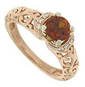 A glowing, round cut madiera topaz is featured as the perfect bloom in this elegant floral inspired engagement ring