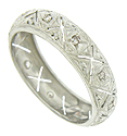 This stunning antique wedding band features abstract organic cutwork set with diamonds