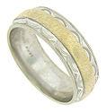 A ribbon of satin polished yellow gold presses into the center of this handsome white gold wedding band