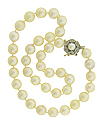 This spectacular strand of 8 1/2 mm cultured pearls is finished with an elegant diamond set clasp