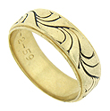 Flowing abstract organic forms cover the surface of this handsome estate wedding band