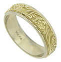 This handsome 14K bi-color wedding band features a deeply engraved organic yellow gold central design