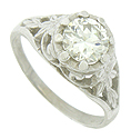 A brilliant, GIA certified, .92 carat, J color, Si1 clarity round cut diamond glows from the center of this antique style engagement ring