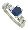 A fantastic .74 carat, emerald cut sapphire rises above the surface of this handsome estate engagement ring