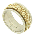 An ornately engraved yellow gold floral band is pressed into the surface of this elegant white gold wedding band