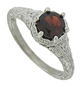 A deep red garnet glows from the face of this dazzling antique style engagement ring