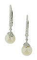 These exquisite pearl and diamond earrings feature a diamond frosted leaf covering single cultured pearls