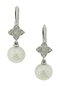These exquisite pearl and diamond earrings feature a diamond frosted floral shaped figure dangling with a single cultured pearl