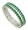 Fashioned of 14K white gold, these elegant stackable wedding bands are set with deep green round cut emeralds