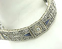 Intricate Edwardian style filigree adorns each of the delicate links on this breathtaking 14K white gold bracelet