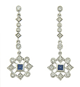 These elegant 14K white gold earrings feature diamond shaped figures set with a single square cut sapphire and round cut diamonds