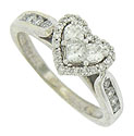 This 14K vintage engagement ring features a  romantic heart shaped center mounting set with custom cut diamonds