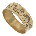 Hand hammered floral decorations press into the surface of this splendid antique wedding band