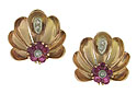 Sprays of 14K rose gold leaves fan out to reveal diminutive flowers of fine faceted rubies
