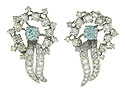 These magnificent 14K white gold estate earrings are set with round cut diamonds surrounding a single round cut aquamarine