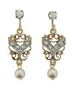 These antique style earrings feature a lacy trellis of yellow gold from which dangles a single luminous pearl