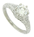This brilliant antique style platinum engagement ring features a GIA certified, 1.02 carat, G color, Vs2 clarity, round cut diamond