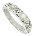 This romantic 14K white gold wedding band features an abstract floral design