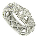 Lacy ribbon cutwork frosted with fine faceted diamonds covers the face of this 14K white gold wedding band