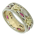 This phenomenal 14K bi-color vintage wedding band features large, yellow gold posies interrupted by trios of round cut diamonds and marquis cut rubies