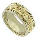 This handsome 14K bi-color mens vintage wedding band features a deeply engraved floral band