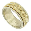 This handmade 14K bi-color wedding band features a deeply engraved floral band