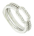 These delicate curved wedding bands are fashioned of 14K white gold and set with a string of fine faceted diamonds