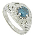 This spectacular 14K white gold engagement ring is set with a .99 carat, Si2 clarity blue diamond