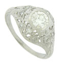 An exquisite .51 carat, GIA certified, G color, Vs1 clarity diamond glows from the face of this elegant platinum engagement ring