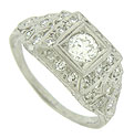 Fashioned of platinum, this elegant antique engagement ring is set with a .41 carat, GIA certified, F color, Si1 clarity diamond