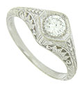 Fashioned of 14K white gold, this romantic engagement ring is set with a brilliant .35 carat, G color, Vs2 clarity diamond