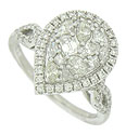 This exquisite 18K white gold engagement ring features an intricate quilt of dazzling diamonds at its center