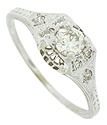 A brilliant .28 carat, G color, Si1 clarity diamond is set into the face of this elegant 14K white gold engagement ring