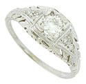 A fantastic .27 carat, H color, Si1 clarity diamond is set into the face of this 14K white gold antique engagement ring