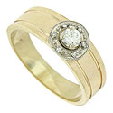 The handsome 14K yellow gold engagement ring features a .20 carat round cut diamond set into the center