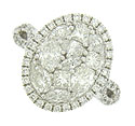 This breathtaking 14K white gold engagement ring is set with a dazzling quilt of diamonds