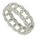 This elegant 14K white gold wedding band features diamond frosted leaves linked together to form an organic chain