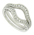 These curved antique style wedding bands are crafted of 14K white gold