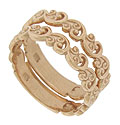 These 14K rose gold stackable wedding bands feature a design of curling vines done in relief