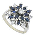 This breathtaking 14K white gold diamond and sapphire estate ring features a floral inspired face