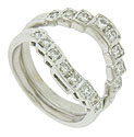 Layers of diamonds are stacked together on the face of these 14K white gold wedding bands