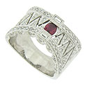 This exceptional 18K white gold wedding band is frosted with fine faceted diamonds and set with a rosy oval cut ruby