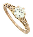 This handsome 14K rose gold engagement ring features a dazzling GIA certified, .65 carat, H color, Vs2 clarity diamond