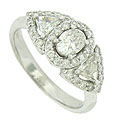This exquisite 14K white gold antique style engagement ring features spectacular oval and trillium cut diamonds