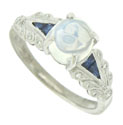 A glorious cabochon cut moonstone glows in the face of this handsome 14K white gold engagement ring