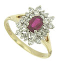 This elegant 14K yellow gold floral inspired ring features a .62 carat oval cut ruby at its center and is surrounded by sprays of round cut diamonds